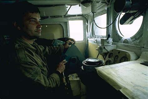 boat steersman photos of solovetski islands