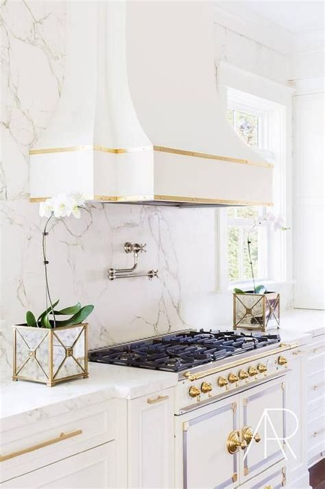white and gold kitchen features white cabinets adorned 25 best ideas about gold kitchen on gold kitchen hardware marble countertops and