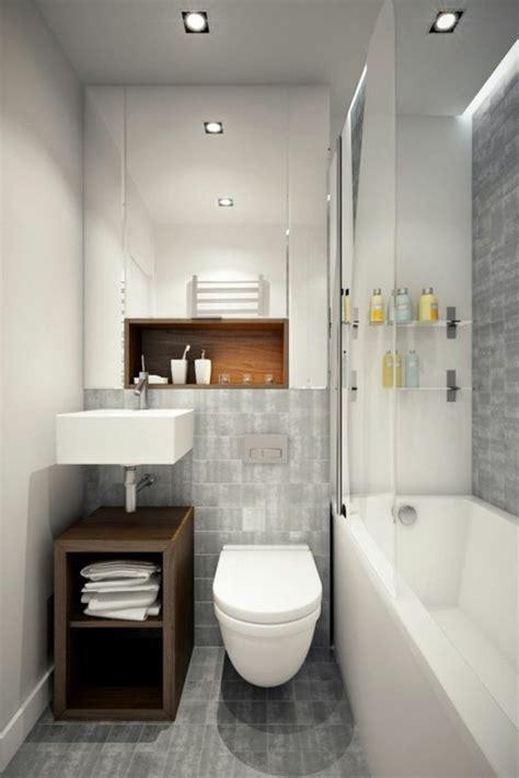 Impressionnant Salle De Bains Noire Et Blanche #3: salle-de-bain-grise-baignoire-blanche-carrelage-gris-meuble-en-bois-fonc%C3%A9.jpg