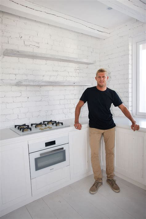 How To Antique White Kitchen Cabinets world champion surfer mick fanning s new caesarstone kitchen
