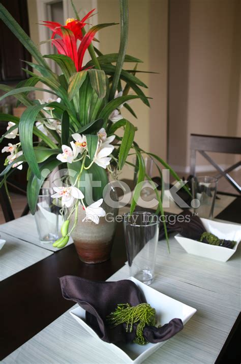 dining room table with floral arrangement stock photos