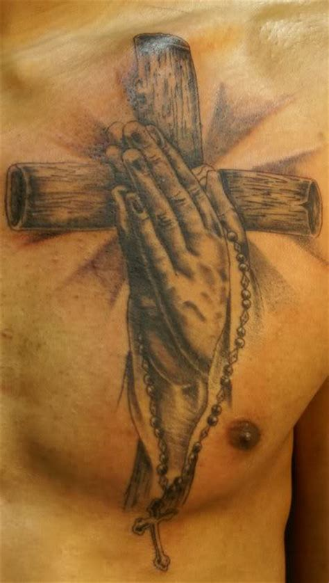 cross with praying hands tattoo cross on chest