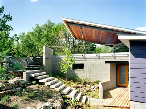 efd home design group modern home built between canopies in austin texas