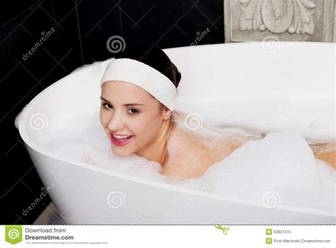 woman in bathtub bathing woman relaxing in bath stock photo image 52827475