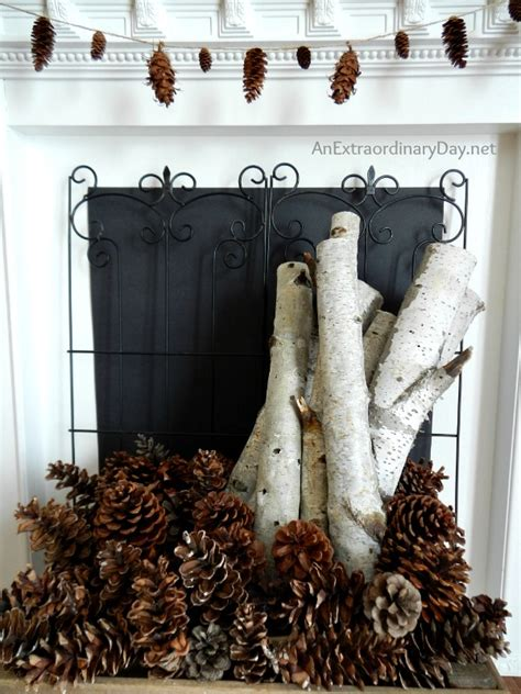 decorating with birch logs decorating the mantel for winter with book page snowflakes