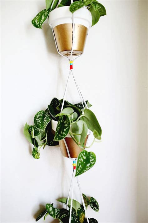 Diy Hanging Plant Holder - gold dipped hanging planters a beautiful mess