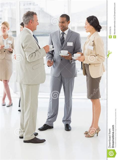 Business People Talking And Drinking Coffee At A Conference Royalty Free Stock Images   Image