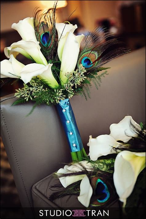peacock feathers in bouquet flower inspiration peacocks weddings theme weddings jevel