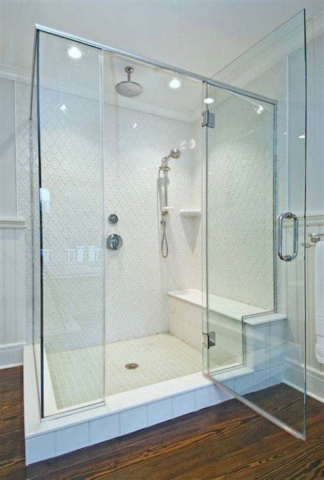 Tiles For Bathroom frameless walk in shower with rain shower heads and bench