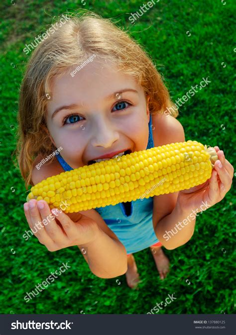 ate corn cob child corn lovely corn stock photo 137880125