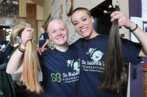 st baldricks women carroll students shave heads to raise money for childhood