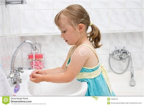 a girl using the bathroom little girl in bathroom stock photography image 15286752