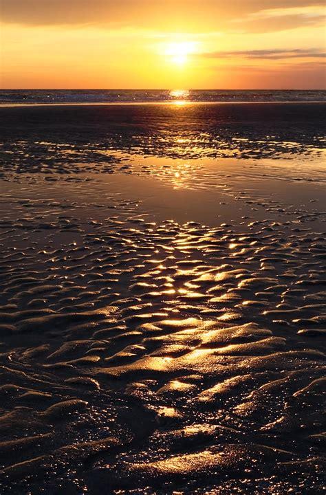 Sunset On The Sand golden sunset on the sand photograph by setsiri