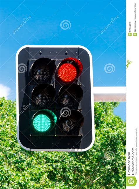 blue lights on traffic lights red and green traffic lights on blue sky stock image