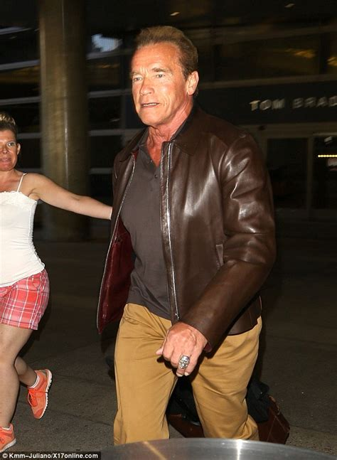 arnold schwarzenegger returns from austria with
