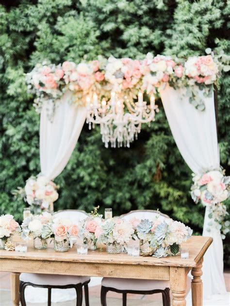 Wedding Arch Cloth by Wedding Arch With Fabric And Chandelier Sweetheart Table