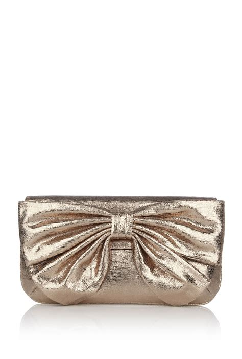 Lulu Guinness Bows Pleats Stella by Lulu Guinness Platinum Sparkle Leather Leona Bow Clutch In