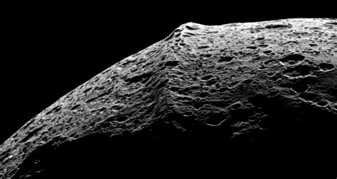 the mighty saturns mountains on saturn moon may come from space