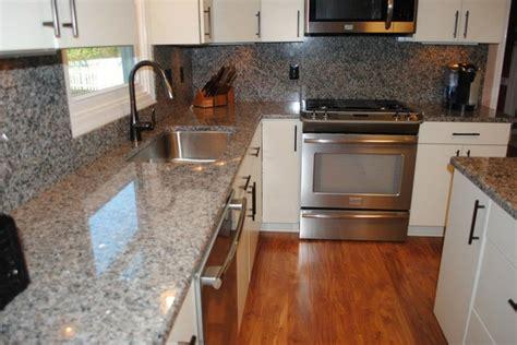 Traditional Backsplashes For Kitchens by Caledonia Granite Tops And Backsplash Laminate Floors