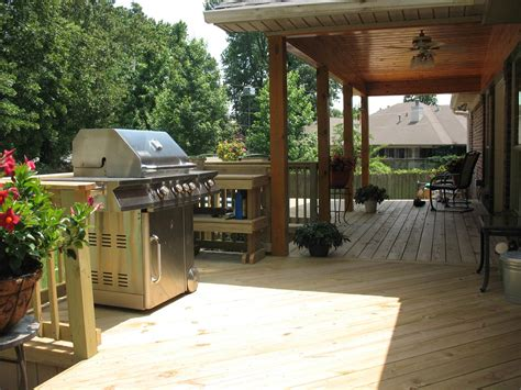 grilling on a deck st louis decks screened porches pergolas by archadeck
