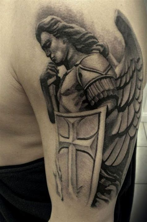 angel tattoo design by daniellehope guardian with shield on shoulder