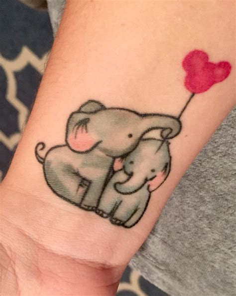 child tattoos baby elephants in honor of my sons family mickey