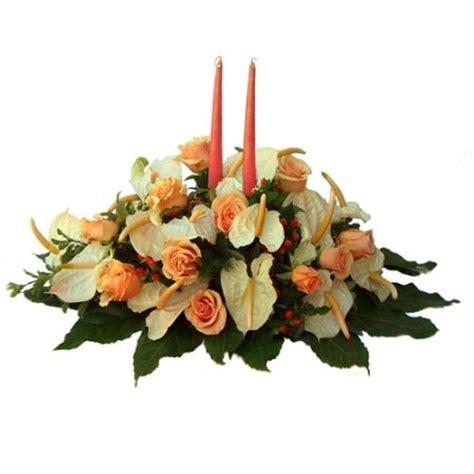 cerco immagini di fiori composizione centrotavola con fiori di stagione e candele