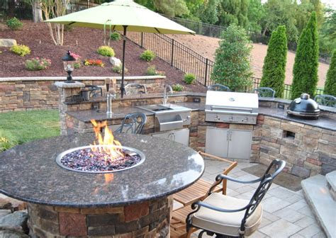 outdoor kitchen with bar custom table and