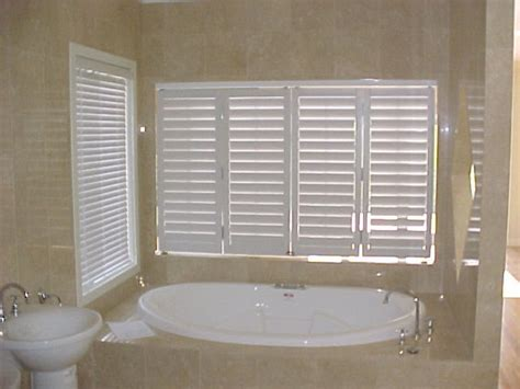bathroom shutters interior shutters this bathroom has white vinyl inter