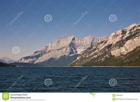 buy fishing boat alberta lake minnewanka banff national park canada stock photo