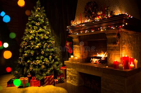 screensaver camino fireplace and decorated tree and candles stock