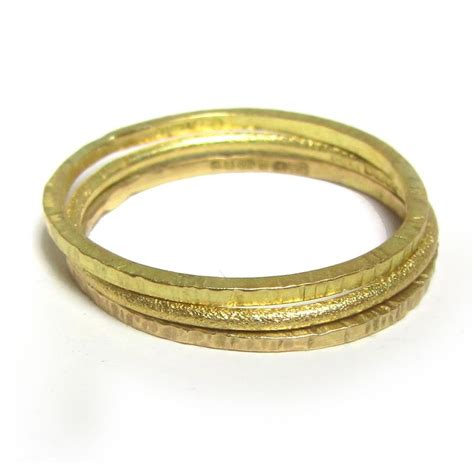 mini stacking ring in 18ct yellow gold textured gold