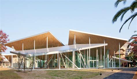 angled roof sanaa places junko fukutake hall beneath angled steel roof