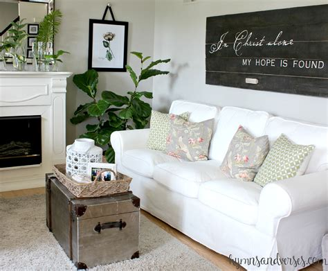 Living Room With White Sofa In Alone Barn Door Sign Hymns And Verses