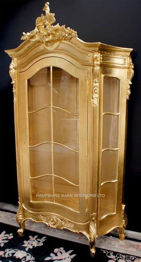 ornate silver leaf display cabinet   gold leaf