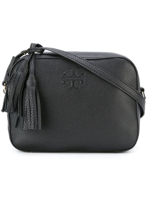 lyst burch tassel detail crossbody bag in black