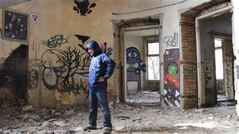 ghetto house depressed bum walking in ghetto house with a graffiti 1920x1080 full hd footage stock