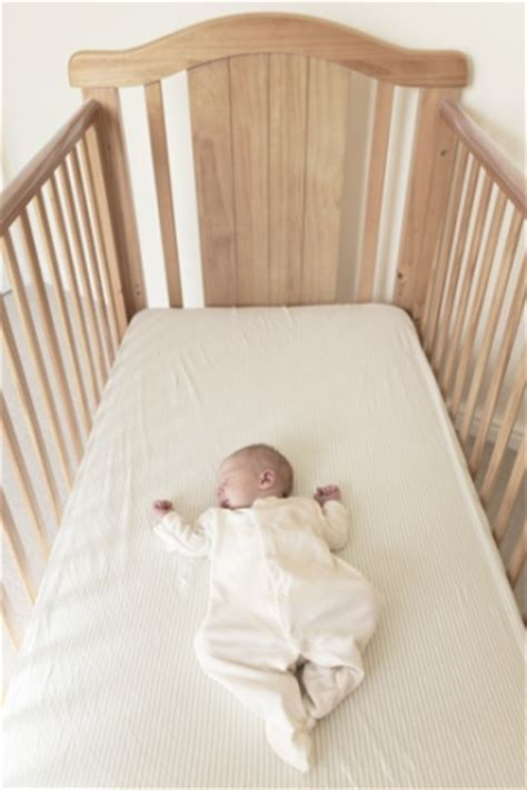Baby Sleeps On Side In Crib For Caregivers Florida Department Of Children And Families