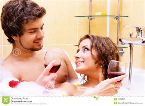 bathroom sexi young couple drinking wine in bath stock photo image