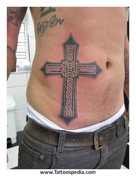 cross tattoo between shoulder blades tony baxter