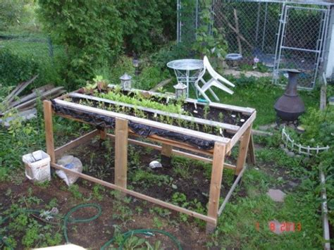 pallet raised garden bed 25 diy ideas using pallets for raised garden beds snappy