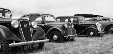 vintage cars in black and white vintage cars in a row