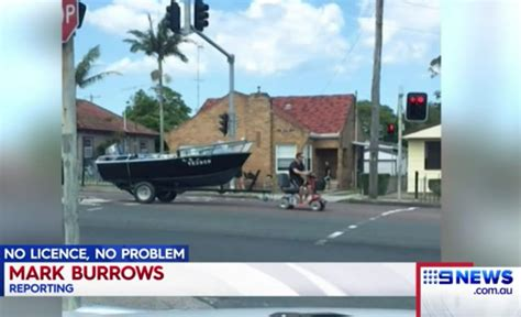 tow boat mobility scooter problem solving australian man tows boat to lake with