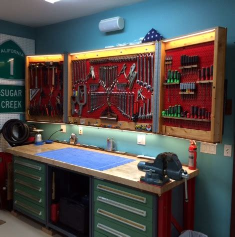 Pegboard Cabinet Doors Pegboard Cabinet Doors Designed To Fold And Lock Wall Pegboard Industrial Garage