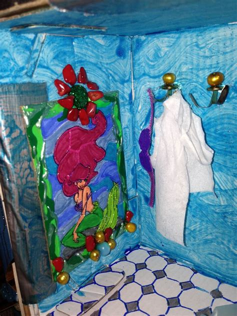 ariel bathroom stained glass of ariel and her bra and bathrobe hanging in the little mermaid themed
