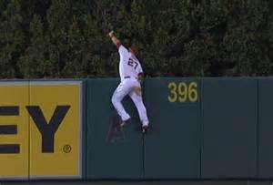 mike trout climbs wall to rob home run larry