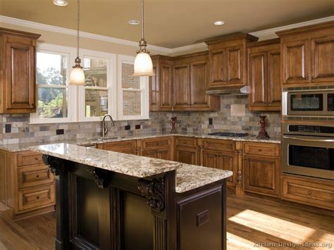 island kitchen cabinets tile backsplash granite countertop oak colored