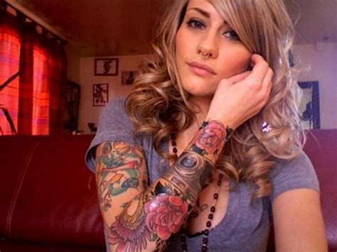 girls with tattoo sleeves with colored flowers sleeve