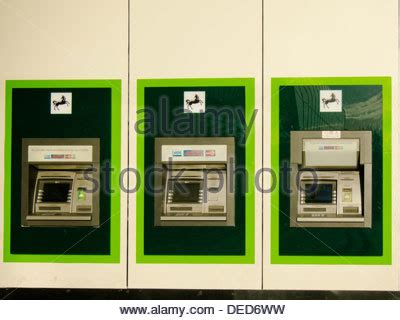 lloyds bank thailand row of atm machines in upmarket shopping mall