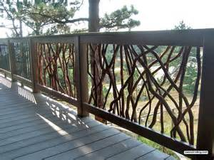deck railing with composite lumber and branch and metal